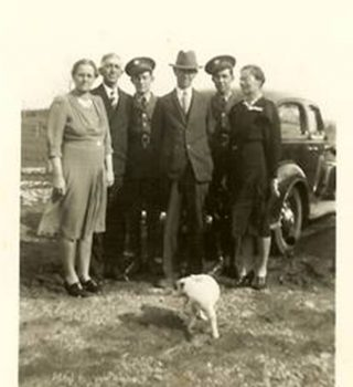 The only known photo of Tip with my dad's aunt and uncle Mary and Fred White, an unidentified soldier, my grandparents Bob and Hattie White with Tom White in uniform.